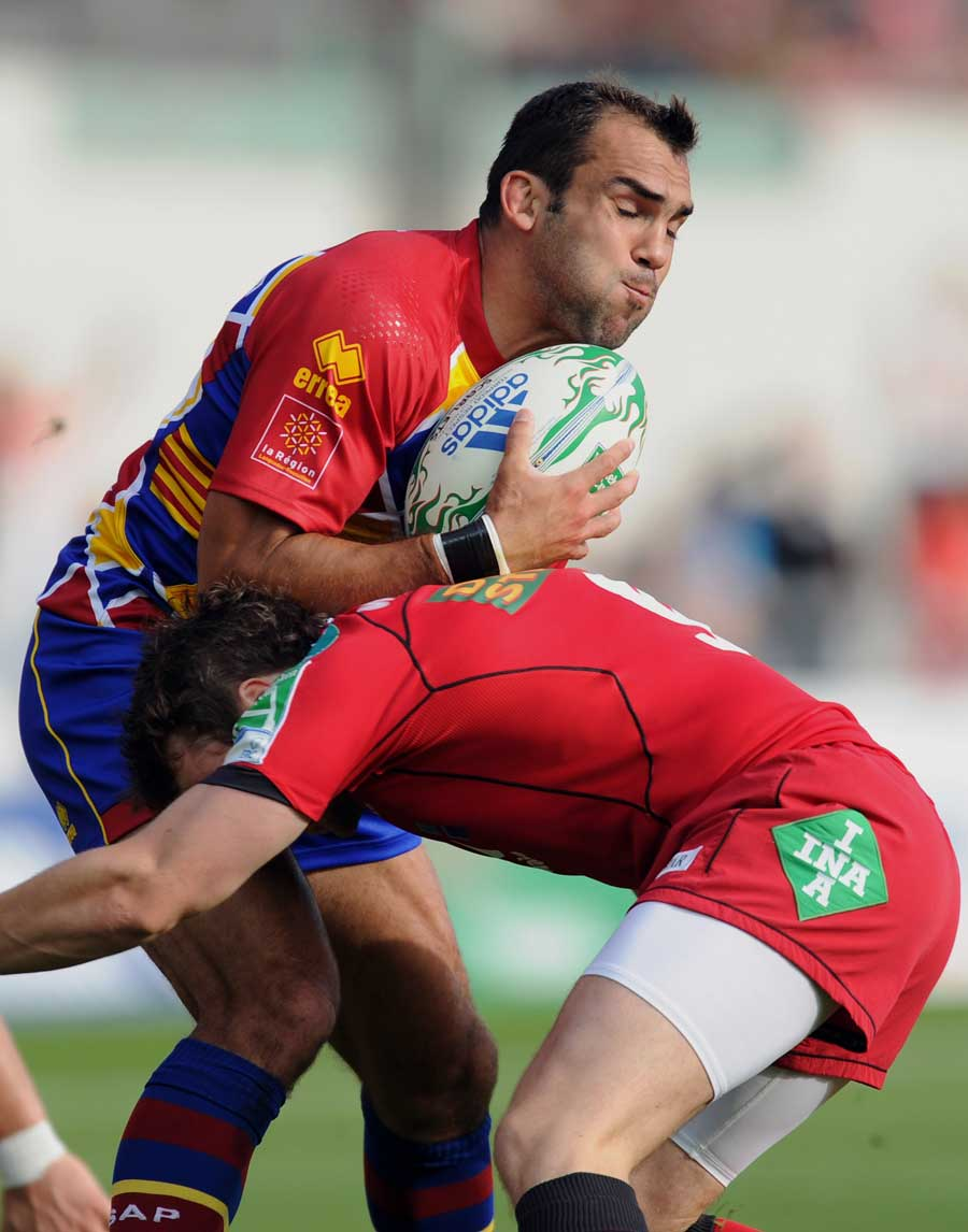 Perpignan centre David Marty is halted by the Scarlets defence