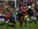 Ronan O'Gara runs straight into a crunching tackle