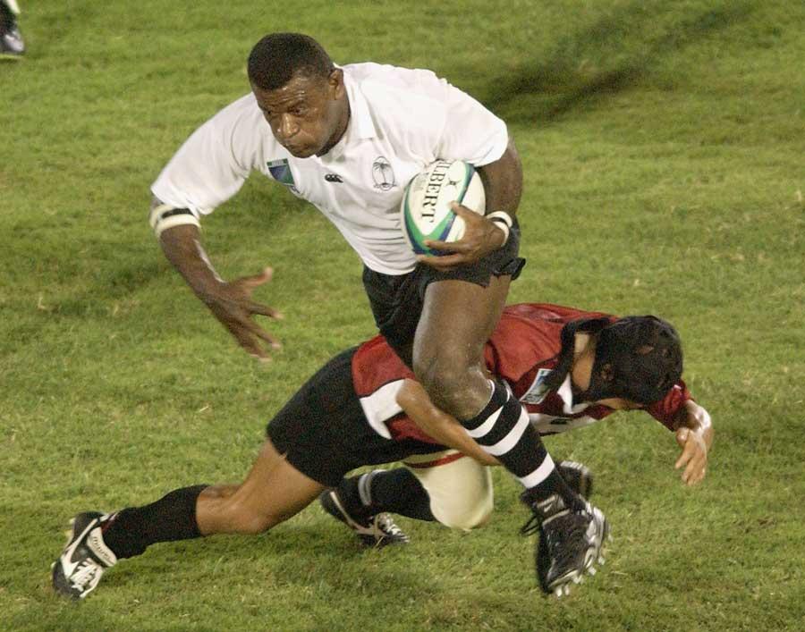 Fiji hooker Isaia Rasila breaks a tackle