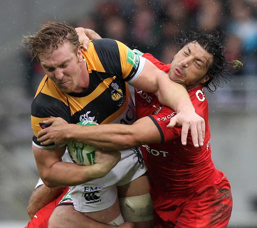 Wasps' Andy Powell is caught by Toulouse's Byron Kelleher