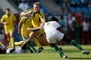 Australia's James Stannard evades a tackle