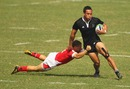 New Zealand's Hosea Gear breaks a tackle