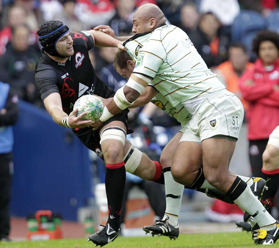 Edinburgh's Fraser McKenzie tries to offload whilst under pressure