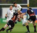Toulouse's Yannick Jauzion hurdles a tackle