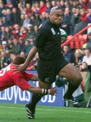 A marauding Jonah Lomu breaks a Tongan tackle to score, New Zealand v Tonga, World Cup, Ashton Gate, October 3 1999