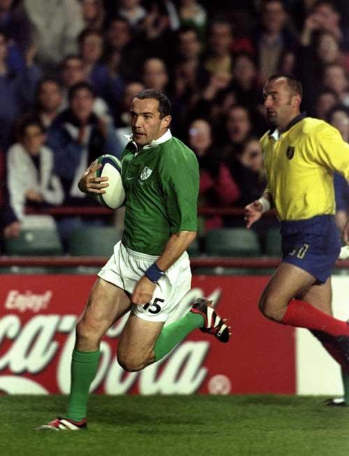 Ireland full-back Conor O'Shea runs in a try