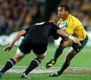 Australia scrum-half Will Genia is caught by the All Blacks' defence