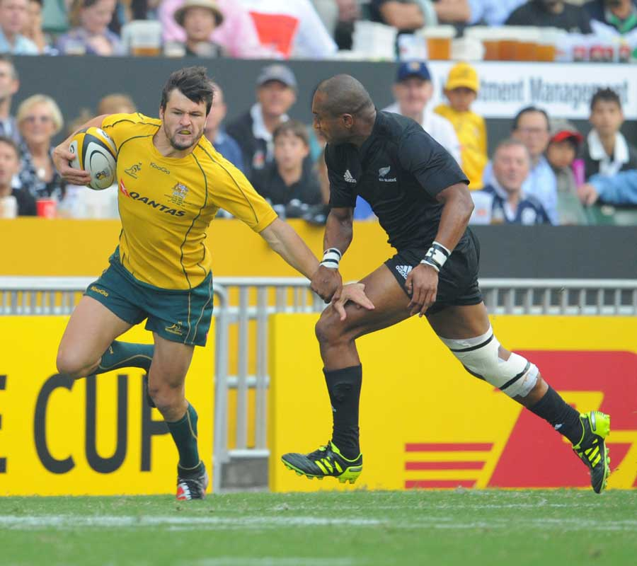 Australia centre Adam Ashley-Cooper takes on Joe Rokocoko