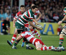 Leicester's Craig Newby looks to off-load the ball