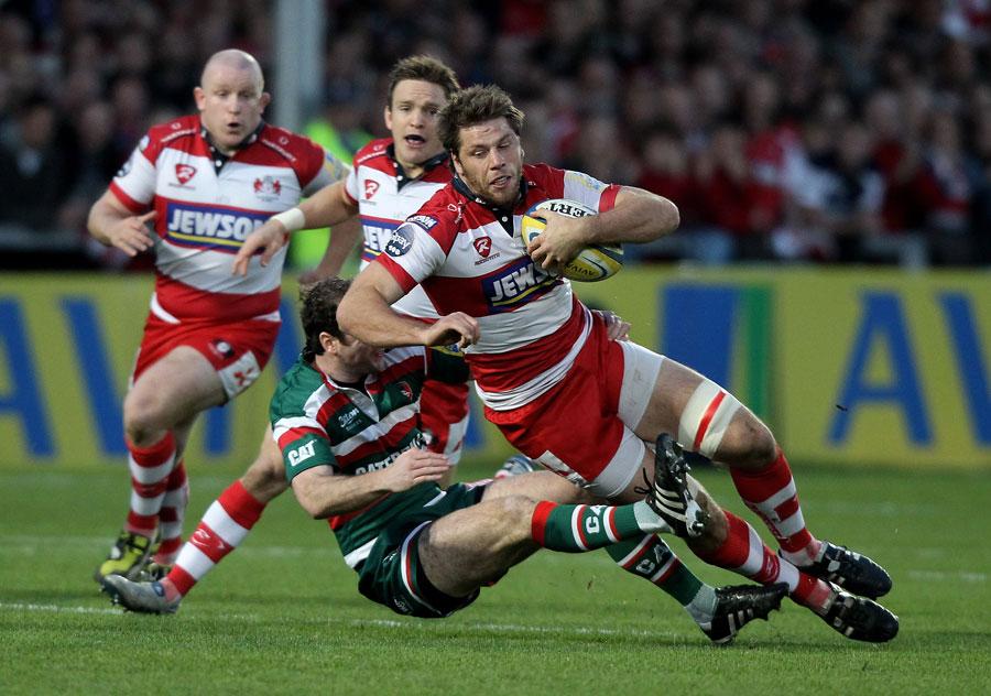 Gloucester's Brett Deacon is taken down by Geordan Murphy