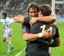 Toulouse's Maxime Medard (L) and Vincent Clerc celebrate