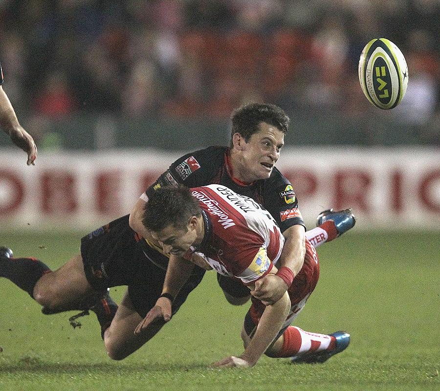 Dragons' Rhodri Gomer-Davis tackles Gloucester's Henry Trinder