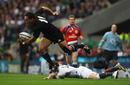 All Blacks wing Hosea Gear skips away from Ben Foden