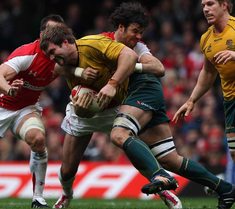 Mike Phillips makes a hit on Australia No 8 Ben McCalman
