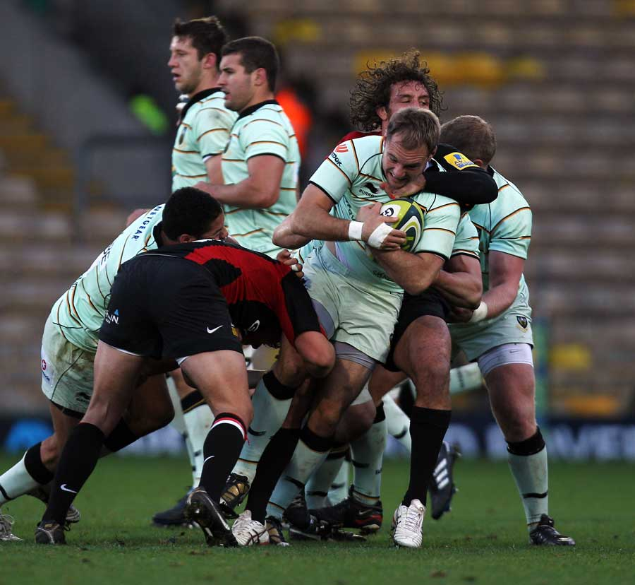 Northampton's Matt Cornwell is wrapped up by the Saracens defence