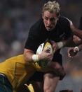 All Blacks scrum-half Jimmy Cowan is tackled