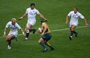 Australia No.10 Matt Giteau takes on the England defence