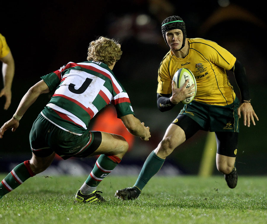 Australia's Berrick Barnes steps inside Billy Twelvetrees