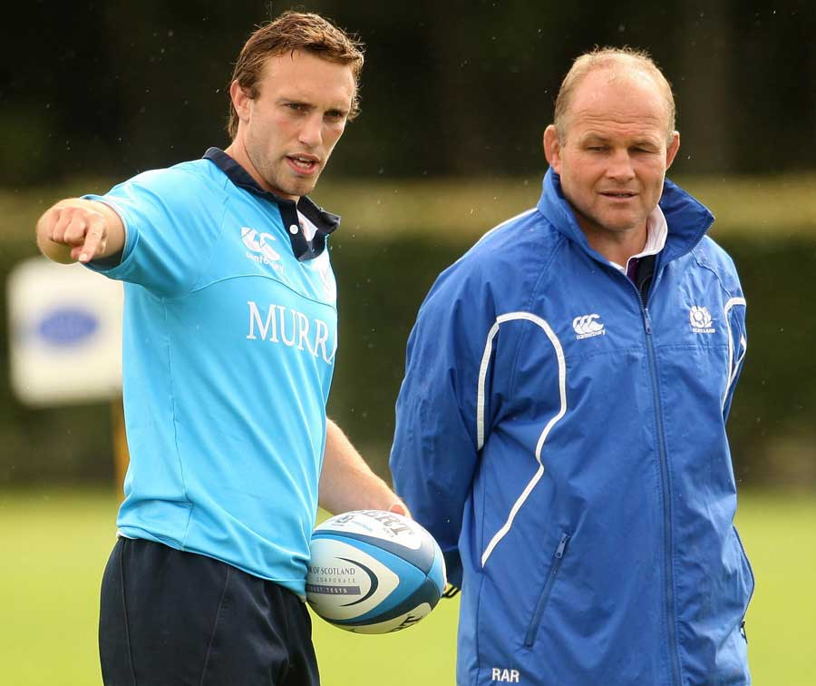 Scotland's Mike Blair chats with head coach Andy Robinson