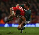 Wales fly-half Stephen Jones is taken down by Ruan Pienaar