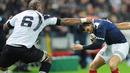 France fullback Jerome Porical evades Semisi Saukawa