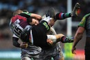 Harlequins' Ross Chisholm is hammered by Micky Young