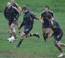 Australia fly-half Berrick Barnes kicks off during training