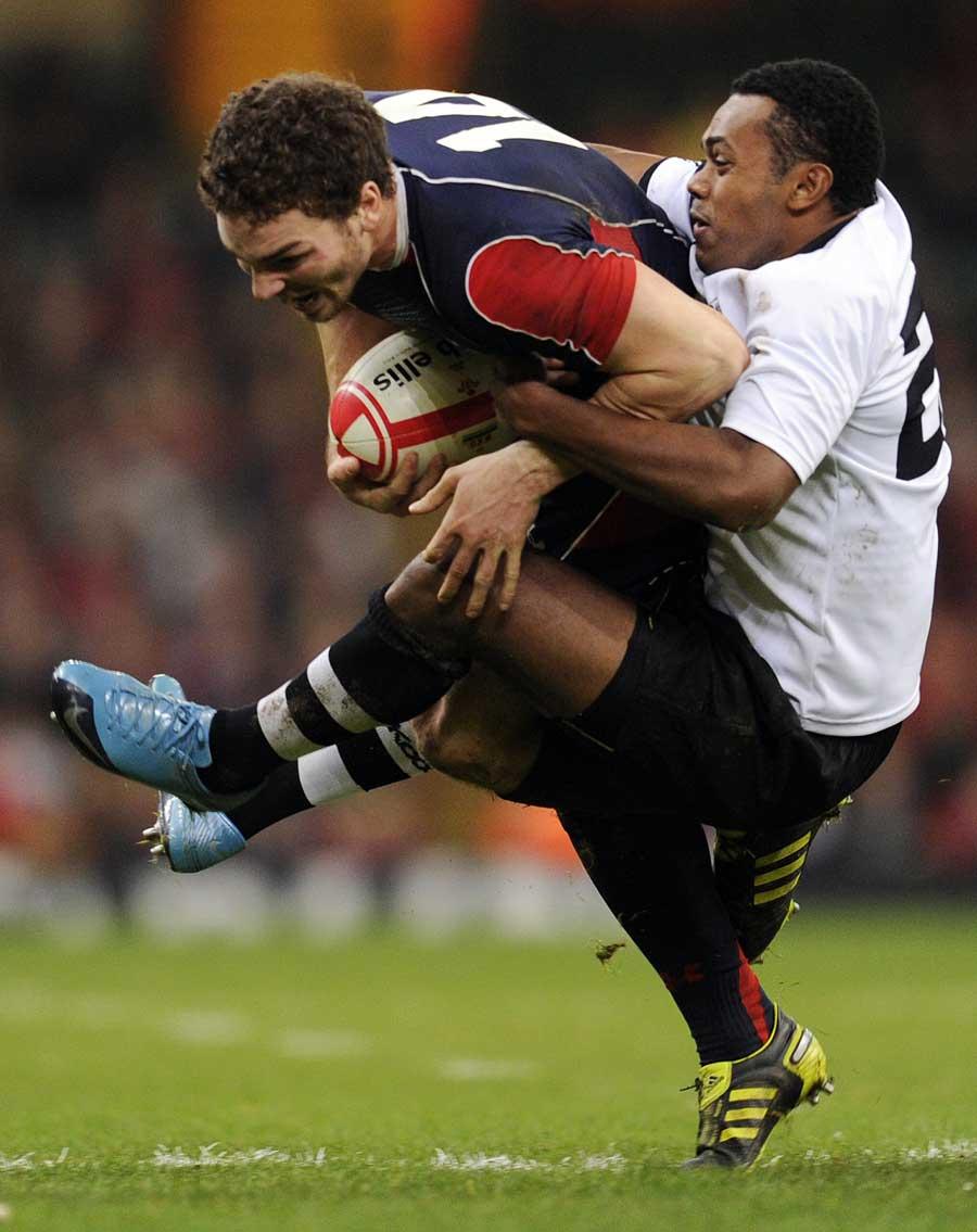 Wales' George North is tackled by Fiji's Taniela Rawaqa