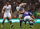 England wing Mark Cueto steps inside David Lemi