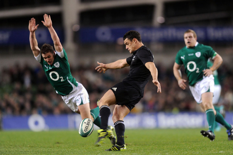 Eoin Reddan attempts to charge down Dan Carter's kick