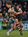 Wasps' Ben Jacobs is tackled by London Irish's Elvis Seveali'i