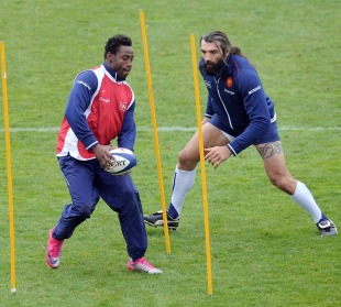 France flanker Fulgence Ouedraogo runs a drill with Sebastien Chabal during training, Marcoussis, France, November 23, 2010