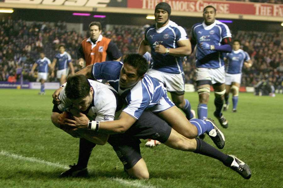 Scotland centre Marcus di Rollo crashes over to score