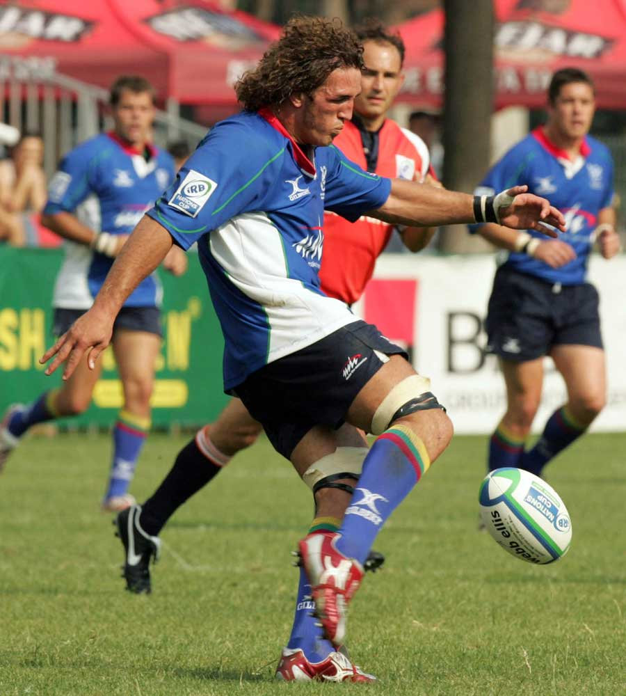Namibia flanker Jacques Burger puts boot to ball