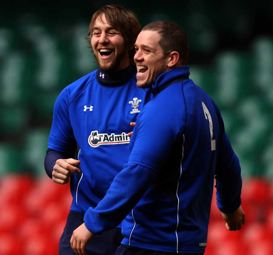 Wales No.8 Ryan Jones shares a laugh with Paul James during training
