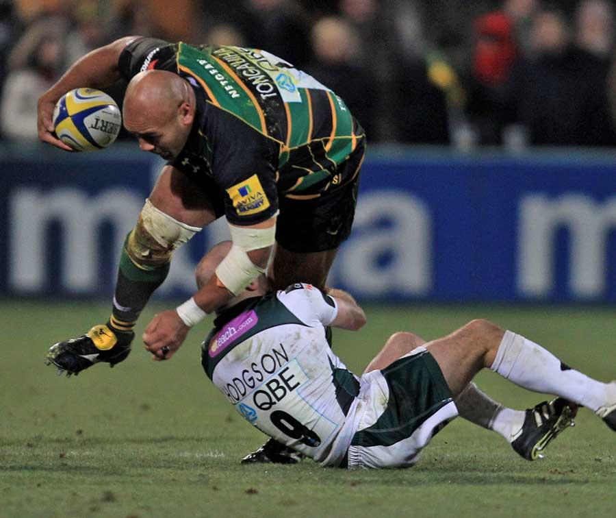 Northampton's Soane Tonga'uiha rides the tackle of London Irish's Paul Hodgson