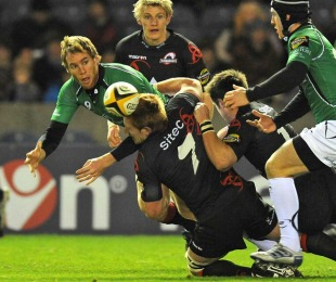 Connacht's Gavin Duffy is tackled by Edinburgh's Roddy Grant
