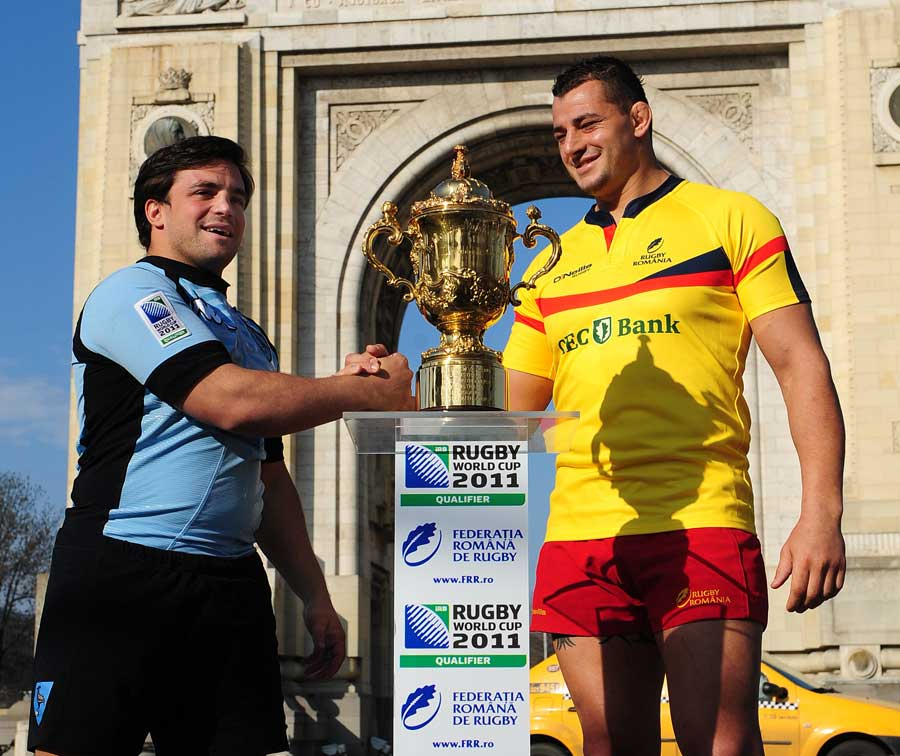 Uruguay's Arboleya Carlos and Romania's Socol Sorin shake hands