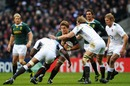 Juan Smith carries the ball into Tom Croft and Courtney Lawes