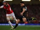 All Blacks fly-half Dan Carter clears under pressure