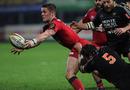 Scarlets scrum-half Tavis Knoyle off-loads under pressure