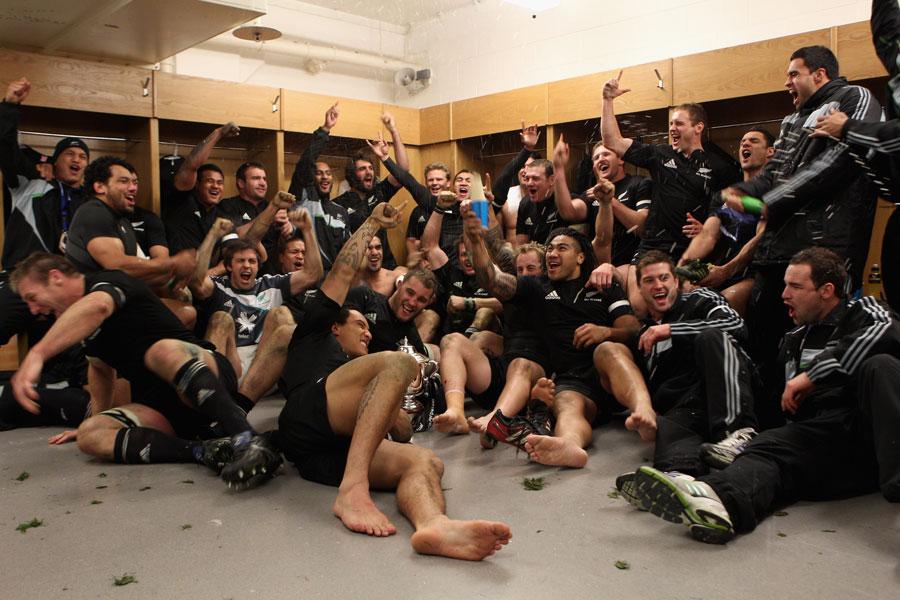 The All Blacks celebrate their grand slam success