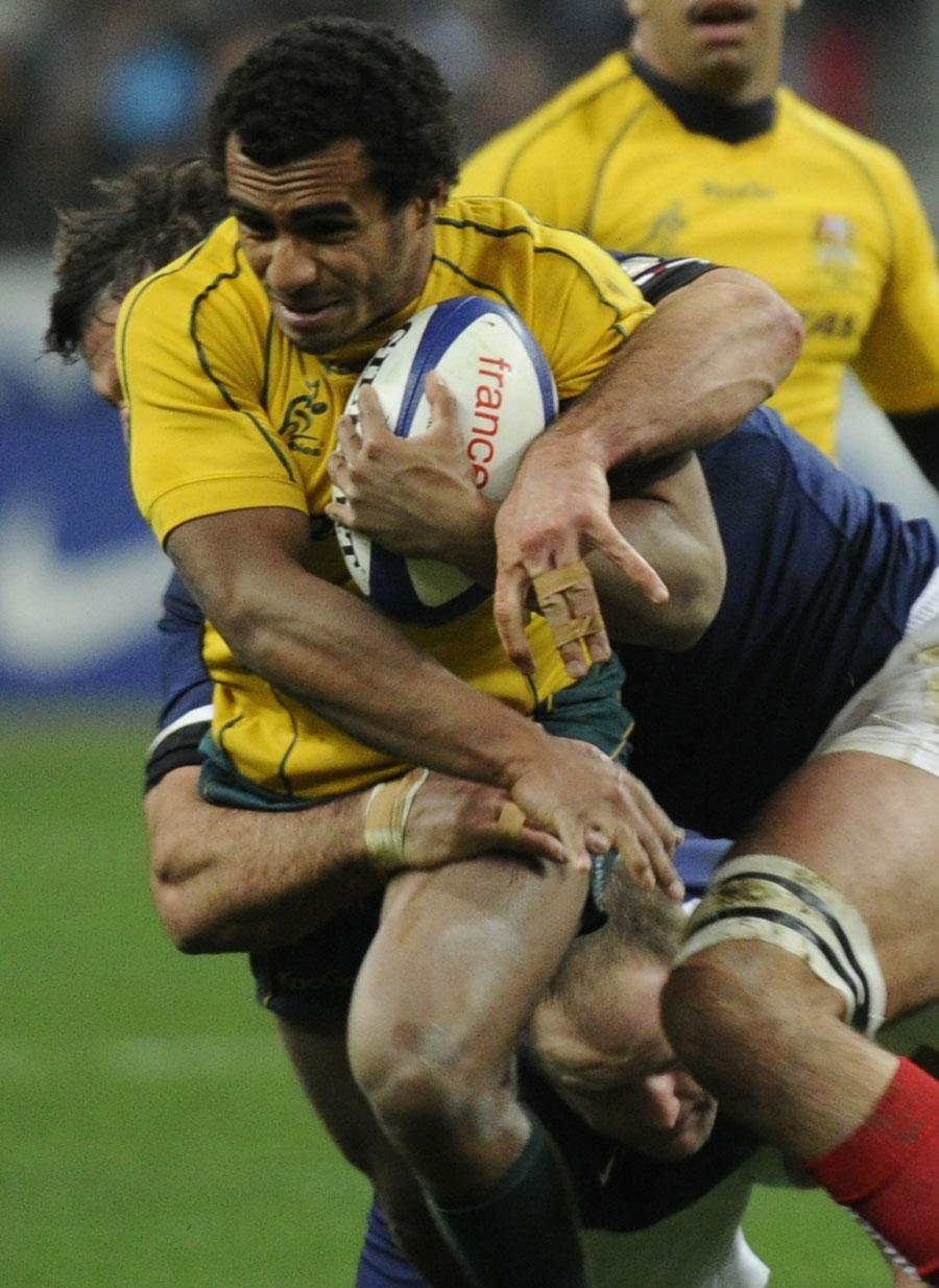 Australia scrum-half Will Genia drives forward