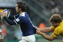 France scrum-half Morgan Parra is held back