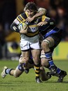 Ben Jacobs is shackled by Bath's defence