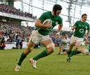 Ireland's Stephen Ferris coasts in for a try