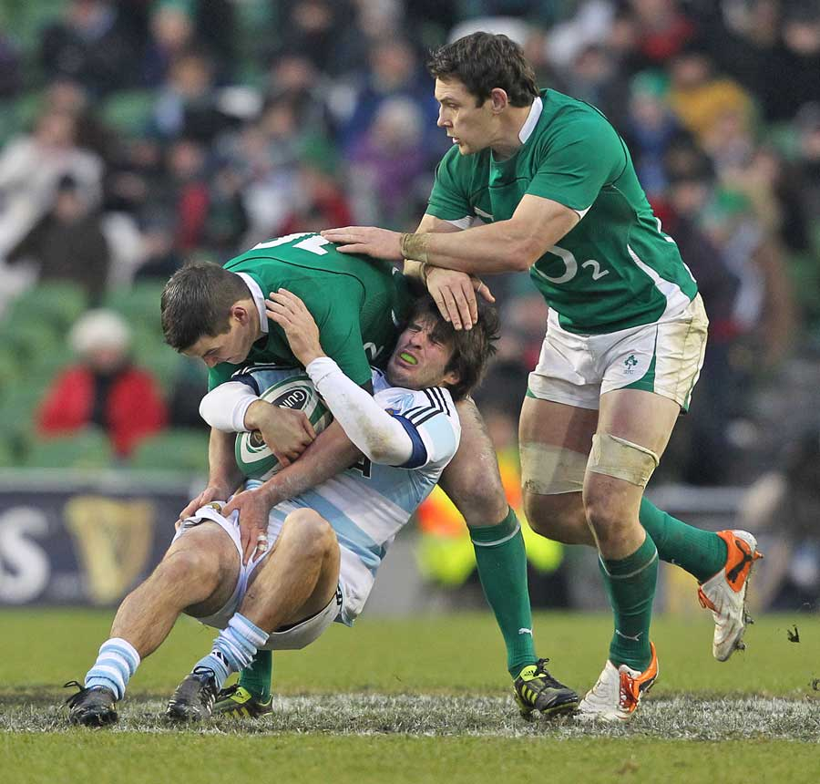 Argentina's Lucas Borges is shackled by the Ireland defence