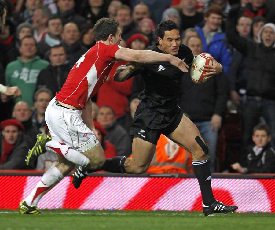 All Blacks wing Hosea Gear breaks away from George North to score