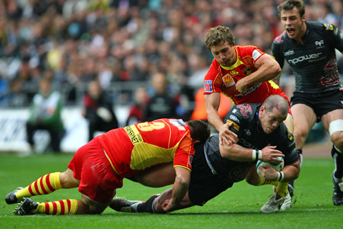Paul James of Ospreys is tackled