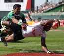 Fiji's Jerry Burotu stretches out to scores a try